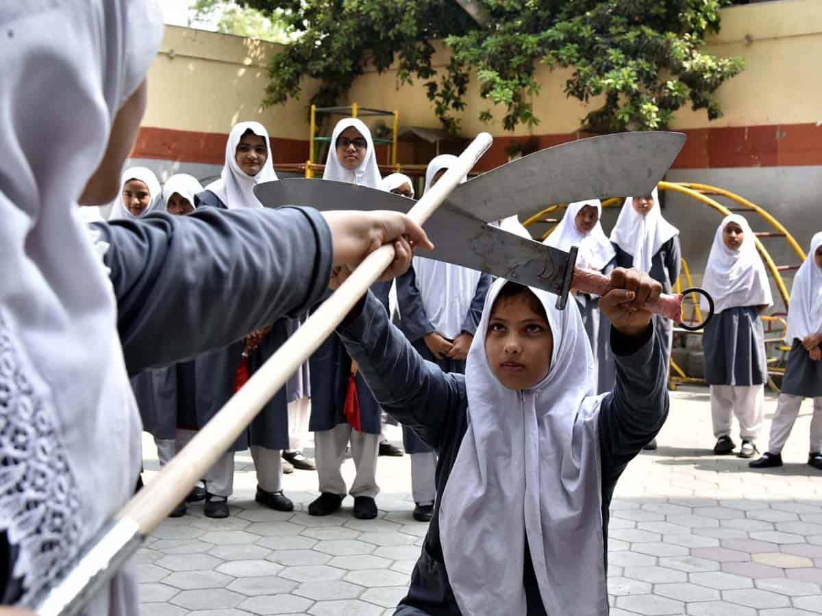 Girl-students display skills in martial arts