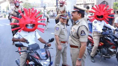 Photo of Cops wear coronavirus helmets to persuade people to stay home