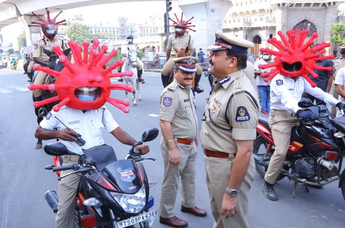 Cops wear coronavirus helmets to persuade people to stay home