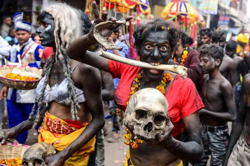 A Hindu devotee of Lord Shiva holds human skull and bone as he takes part in a religious procession to mark the Hindu festival of Maha Shivratri in Allahabad on February 21, 2020. SANJAY KANOJIA / AFP