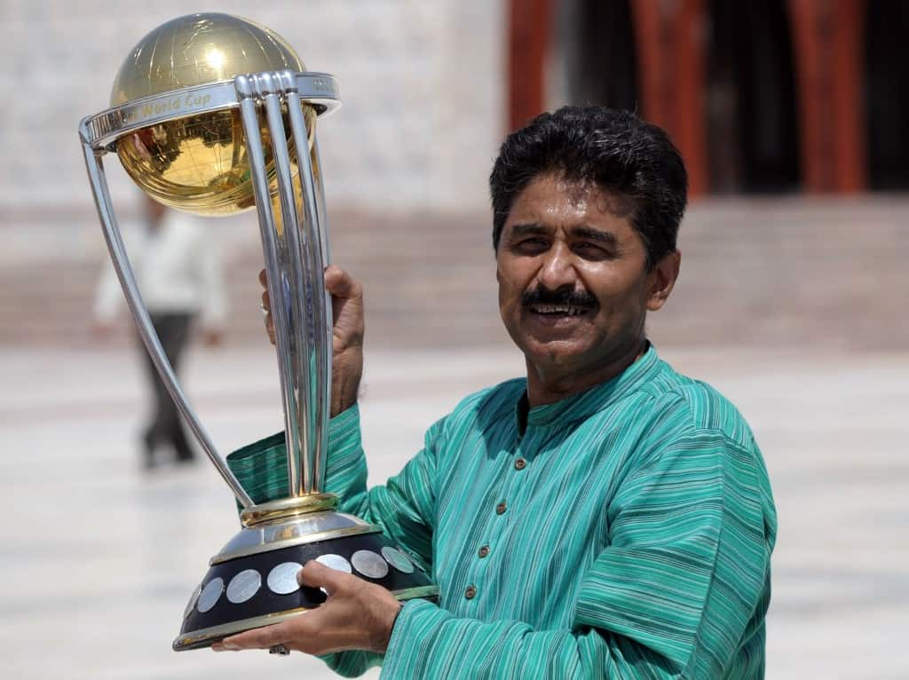 In this file photo taken on September 18, 2014 former Pakistan's cricketer Javed Miandad poses for a photograph with the ICC World Cup 2015 trophy during a ceremony at the mausoleum of the country's founder Mohammad Ali Jinnah in Karachi.