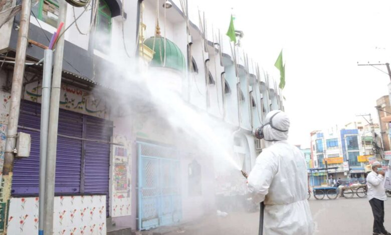 DRF personnel disinfecting the roads, mosque of Hyderabad's Old City in Talab Katta. Photo Mohammed Hussain