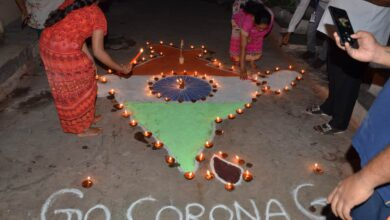 Photo of People light candles, diyas to mark fight against COVID-19