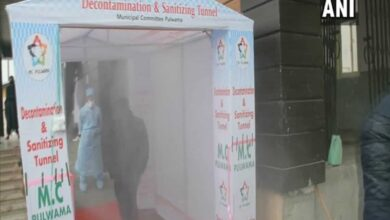 Photo of J-K: Sanitisation tunnel set up at entry of isolation facility
