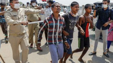 Photo of Migrants hurl stones at police in Ahmedabad; 100 detained