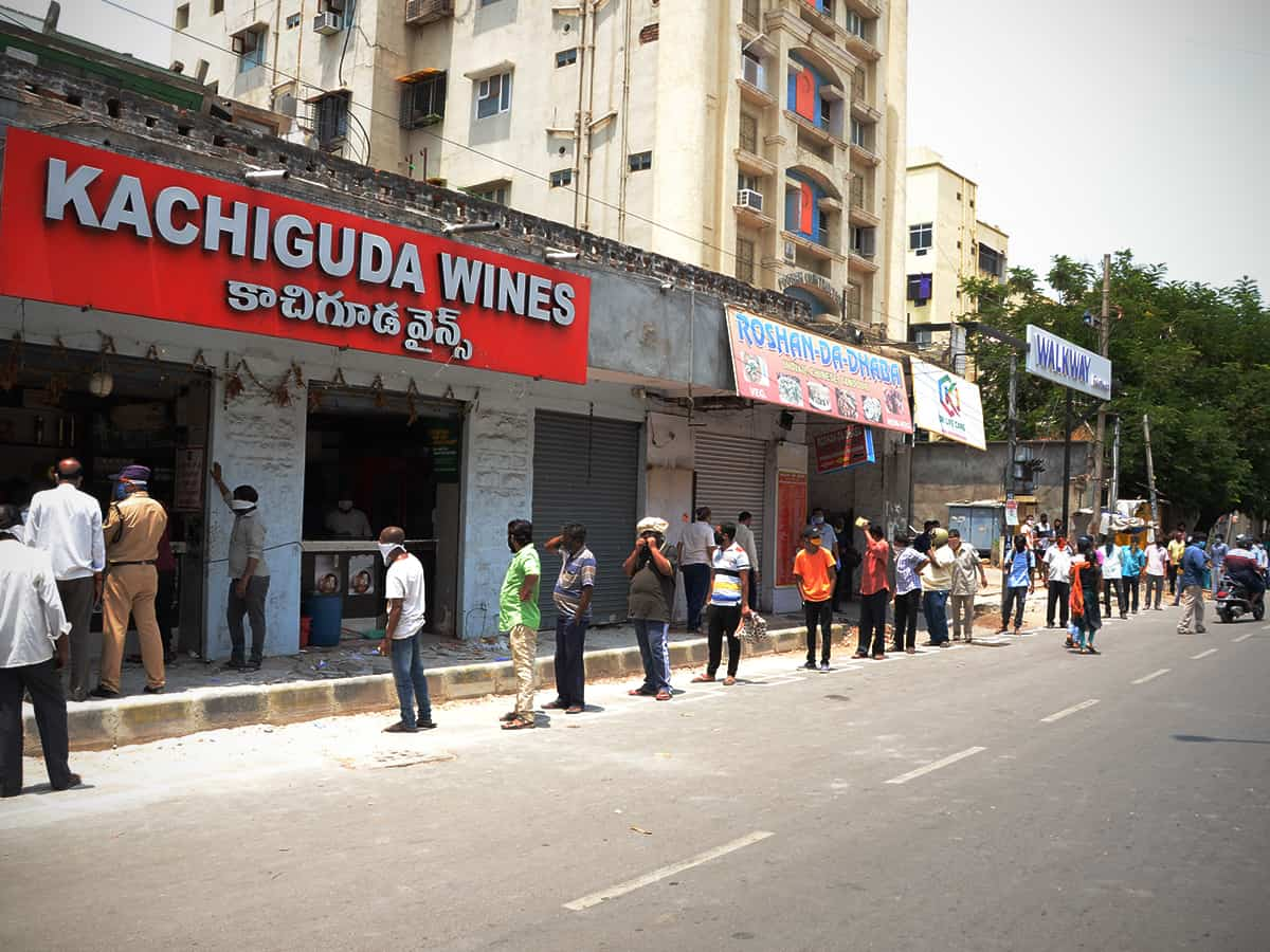 Liquor shops reopen in Telangana, tipplers throng stores