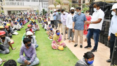 Photo of GHMC ensuring safety of migrant workers as they get to work
