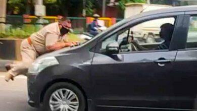 Photo of Cop dragged on car bonnet in Jalandhar, driver held