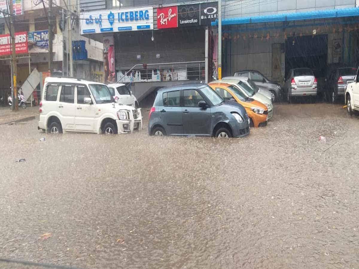 Hyderabad rain leaves puddles on roads