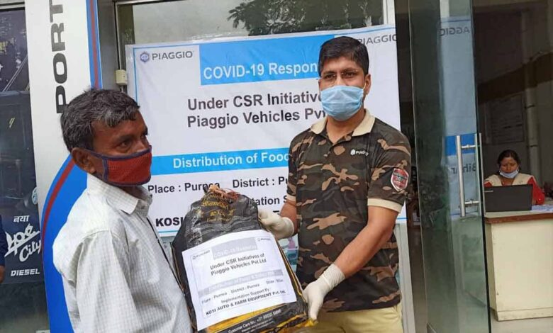 Piaggio donates 11000 + ration Kits to auto drivers