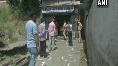 Photo of People queue outside liquor shop in Jammu