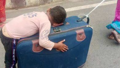 Photo of Video of migrant kid sleeping on suitcase goes viral