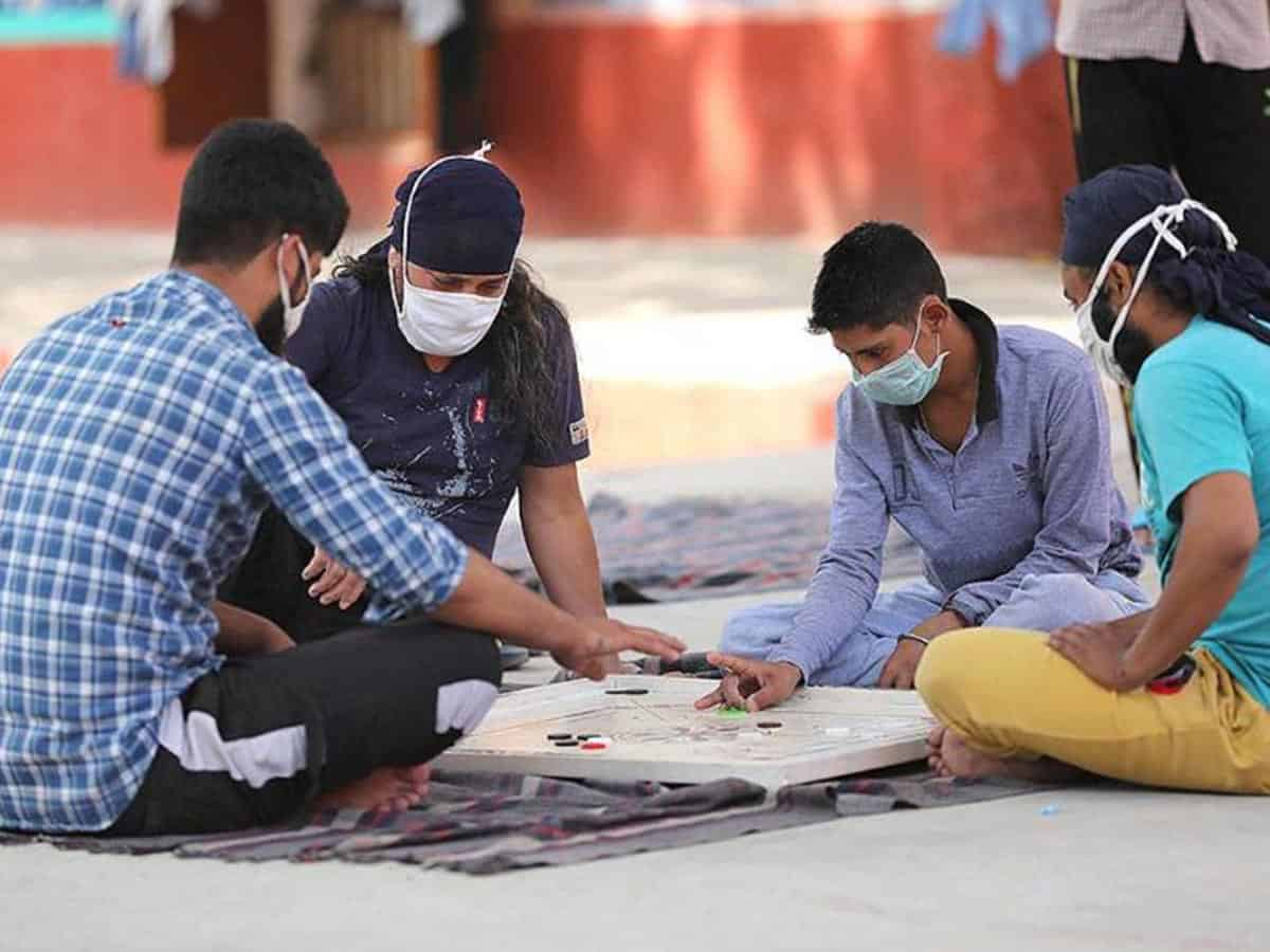 In this file photo, inmates wearing protective masks play carrom inside a jail during the nationwide lokcdown to curb the spread of coronavirus, in Jammu. (PTI)