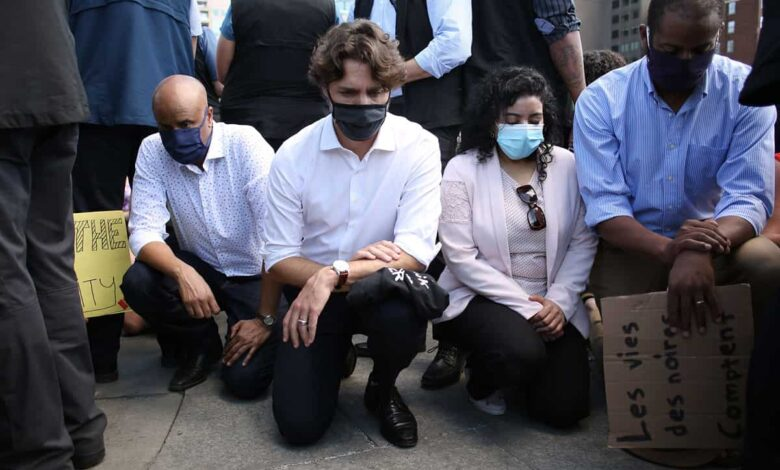 Justin Trudeau takes a knee at anti-racism protest