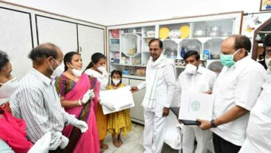 Telangana CM hands over cheques, job letter to martyred Colonel's kin