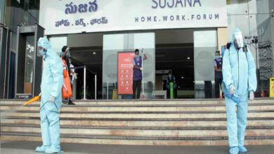 Staff of Forum Sujana Mall spraying disinfectants at the mall entrance in Hyderabad. Photo: Mohammed Hussain