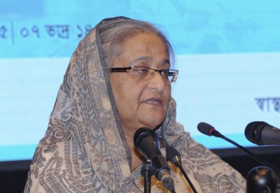 Hasina asks officials to extend help to flood-hit people