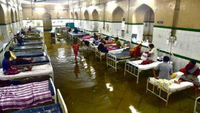Photo of Patients, staff wade through knee-deep rainwater in Osmania hospital