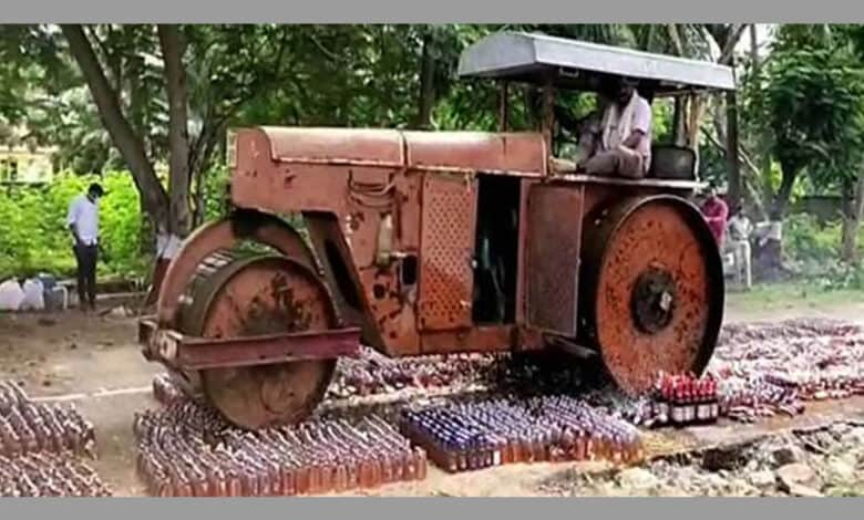Andhra police destroys liquor worth Rs 72 lakh with a road roller