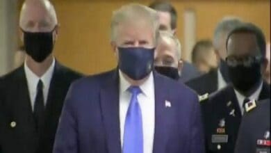 Photo of Trump wears mask on camera for first time