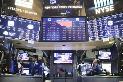 US stocks fall as traders eye earnings, Covid-19 relief package