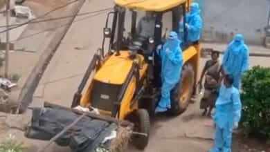 Photo of Shifting of deceased corona patient via JCB tractor draws criticism