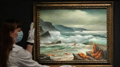 Photo of Banksy donates migrant crisis paintings to charity