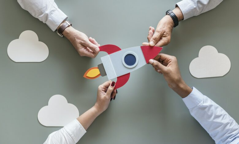 Business people with startup rocket
