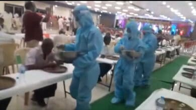 Photo of Watch: Waiters serve guests wearing PPE kits at wedding function