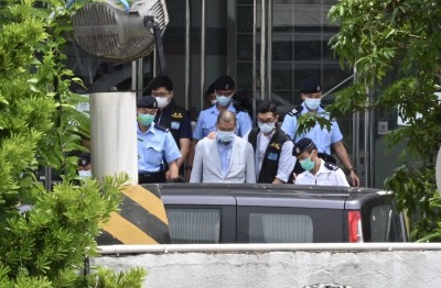 Arrested Hong Kong tycoon tells protesters to be 'careful'