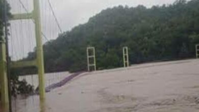 Photo of Two youngsters slip into floodwater in WM Highway, goes missing
