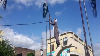 Photo of Activist brings down Pakistani flags in PoK