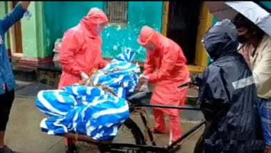 Photo of Denied ambulance service, family transports body on bicycle
