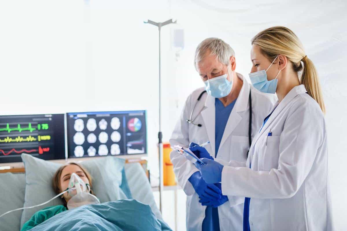 Doctors and infected patient in quarantine in hospital, coronavirus concept
