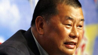 Photo of Hong Kong media tycoon Jimmy Lai arrested, newsroom searched