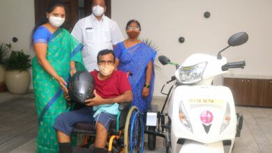 Photo of Kavitha handed over a scooter to disabled engineer
