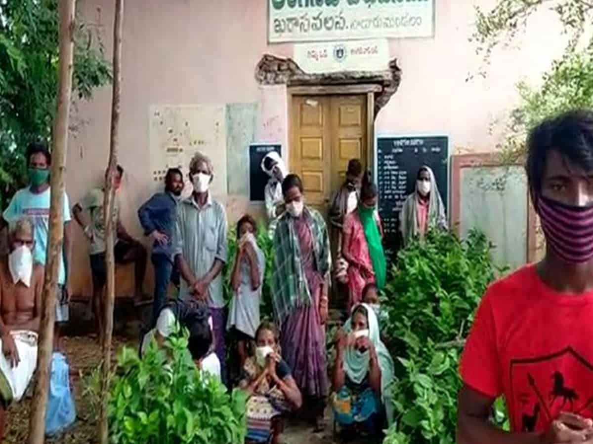 Vizianagaram (Andhra Pradesh) [India], Aug 11 (ANI): More than 15 people who were tested positive for COVID-19 in Kharasavalasa village, Salur Mandal of Vizianagaram district have taken shelter under a tree shade claiming lack of facility being provided by the administration. The news came to light after the video of the same went viral on social media platforms.