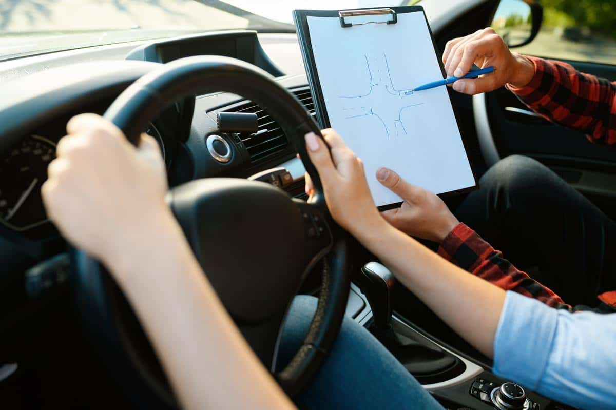 Woman and man with checklist, driving school