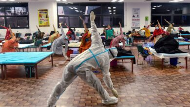 Photo of Patients perform yoga at COVID-19 Care Centre