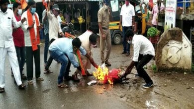 Photo of BJP workers burn effigy of Civil Supplies minister after remarks on temple attacks