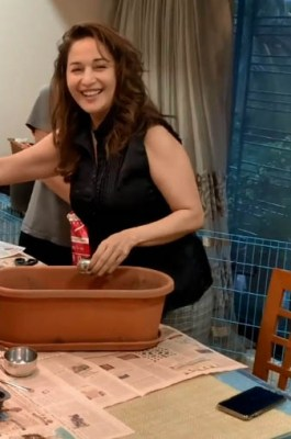 Madhuri's family pitches in to help out with her kitchen garden