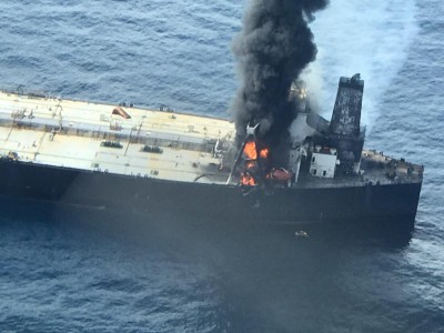 Oil tanker blaze under control, vessel towed to stop drift into shallows (Roundup)