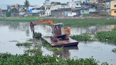 Photo of Weeds being removed from Shah Hatim Talab