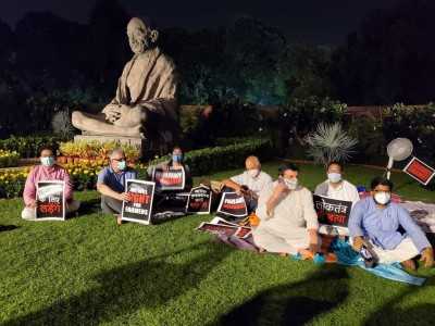Singing, sitting on grass: 8 suspended MPs continue dharna