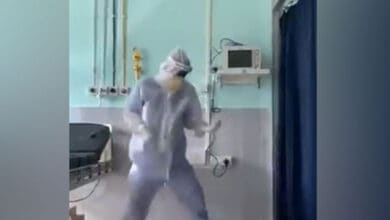 Photo of Doctor dances in PPE suit to cheer up COVID-19 patients in Assam