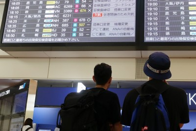 Japan eases travel curbs for foreigners who aren't tourists