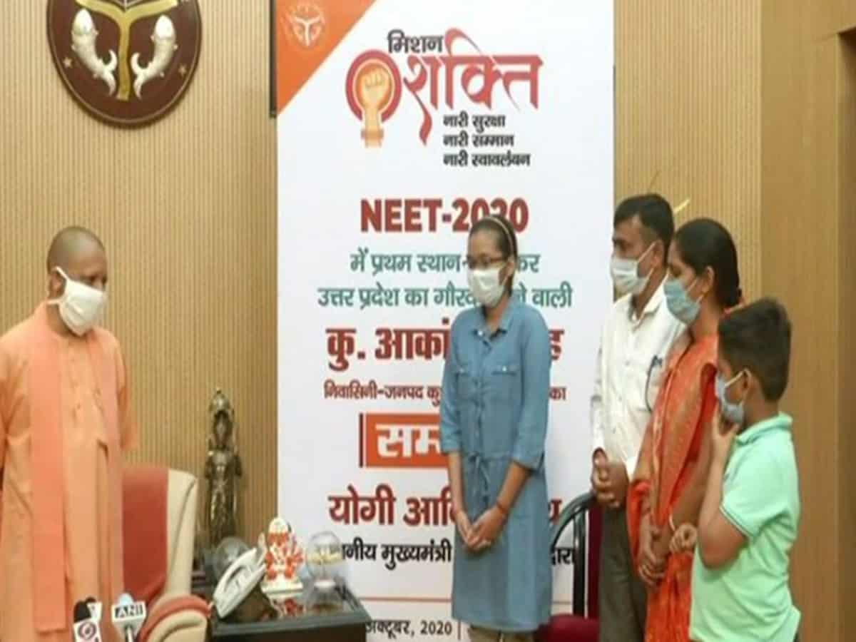 Yogi Adityanath felicitates UP NEET topper Akanksha Singh