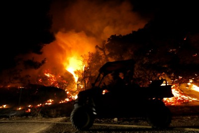 Over 13,800 firefighters battle 21 major wildfires in California