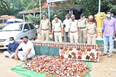 Chittoor police arrest two, seize 1k Karnataka liquor bottles