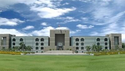 Justice Vineet Kothari takes oath as Gujarat HC judge